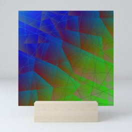 Bright fragments of crystals on irregularly shaped blue and green triangles. Mini Art Print