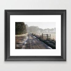 Remote frozen country road a t sunrise. Norfolk, UK. Framed Art Print