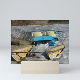 Sea holidays concept. Catamaran standing on snow. Mini Art Print