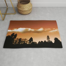 Silhouetted trees Rug
