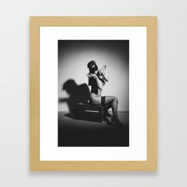 Nude woman cuffed with handcuffs Framed Art Print