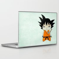 goku Laptop & iPad Skins featuring A Boy - Goku by Christophe Chiozzi