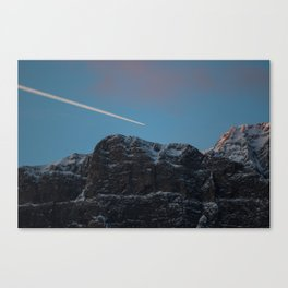 Plane Flying Over Mountains in Sunrise Canvas Print