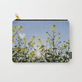 Detail of Rapeseed (Canola) under a blue sky. Norfolk, UK. Carry-All Pouch