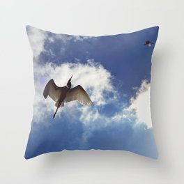 Egrets soaring against blue sky Throw Pillow