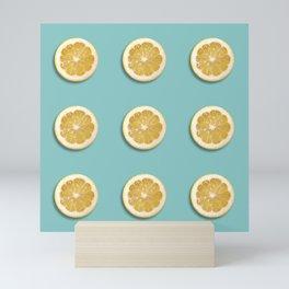 Lemon slices on teal green Mini Art Print