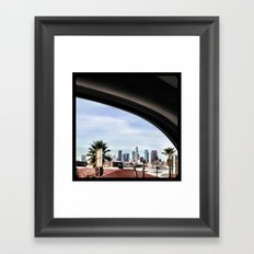 Driving by the LA skyline. Framed Art Print