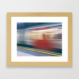 Speeding in London Underground Station Framed Art Print