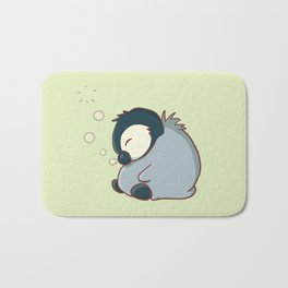 Sleepy baby penguin Bath Mat