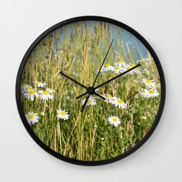 Wildflowers along the lake Wall Clock