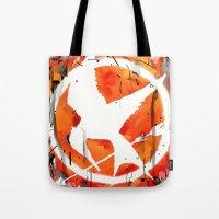 mockingjay Tote Bags featuring The Mockingjay by Trinity Bennett