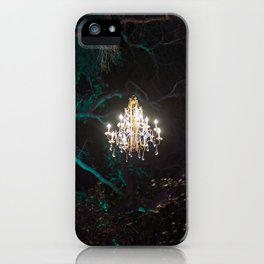 Enchanted forest of light - brightly lit chandelier magically hovering in the middle of the forest iPhone Case