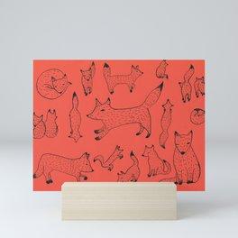 Orange foxes Mini Art Print