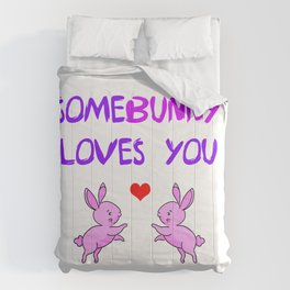 Some bunny loves you wordplay. Funny animal pun. Two little playful cute pink bunnies and red heart Comforters