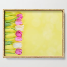 Row of multicolored tulips for border or frame over yellow blurred background Serving Tray