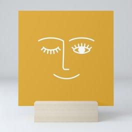 wink / mustard Mini Art Print