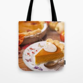 II - Homemade pumpkin pie on a rustic table with autumn decorations Tote Bag