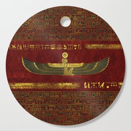 Golden Egyptian God Ornament on red leather Cutting Board
