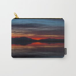Final light of sunset turning sky and water red Carry-All Pouch