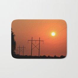 Power Line Silhouettes with a Blazing Orange Sky in Kansas Bath Mat