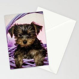 Yorkshire Terrier Puppy Sitting in a Purple Basket with Purple Floral Decorations and a Pink Backgro Stationery Cards