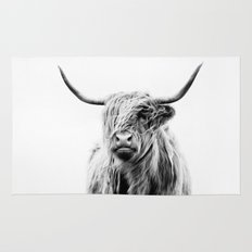 portrait of a highland cow Rug