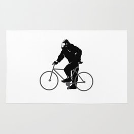 Bigfoot  riding bicycle Rug