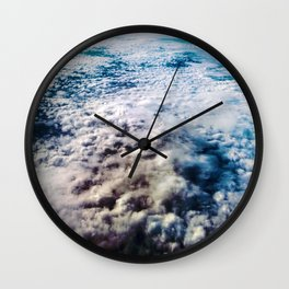 on the churning sea of clouds Wall Clock