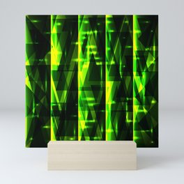 Luxurious green stripes and metallic triangles of blades of grass create abstraction and glow. Mini Art Print