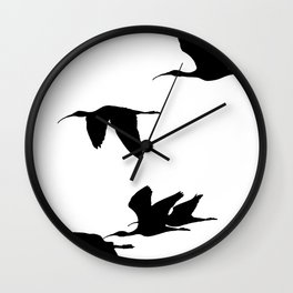 Silhouette of Glossy Ibises In Flight Wall Clock