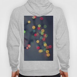 Blurred background with multicolored lights of garland Hoody