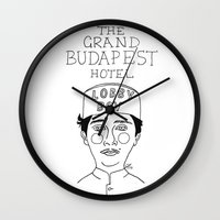 budapest hotel Wall Clocks featuring The Grand Budapest Hotel by ☿ cactei ☿