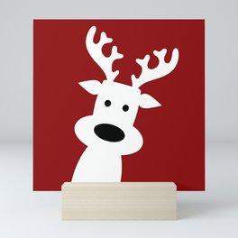 Reindeer on red background Mini Art Print