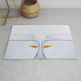 Tw goldfish staring at each other through different bowls Rug