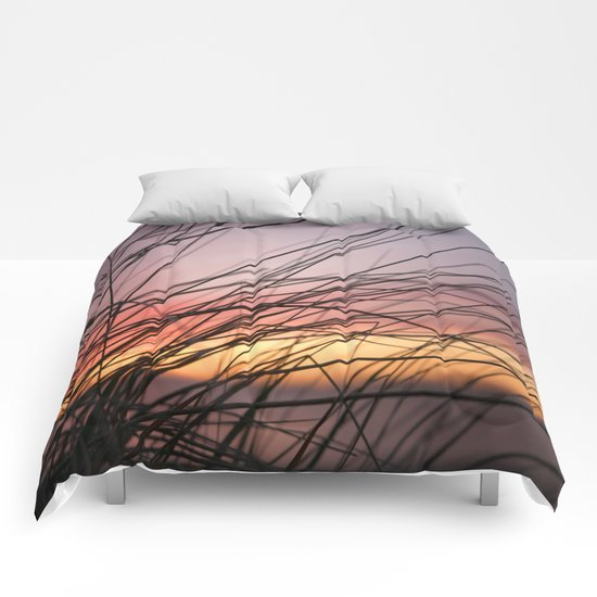 Grasses in the rainbow light of sunset Comforters