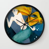 the little mermaid Wall Clocks featuring little mermaid by genie espinosa