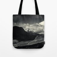 nan lawson Tote Bags featuring Sgùrr nan Gillean and Loch na Creitheach from Camasunary, Isle of Skye by Ferdinand Bardamu