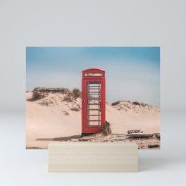 Red telephone box on a deserted beach Mini Art Print