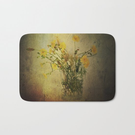 One Glass with pretty yellow weeds Bath Mat