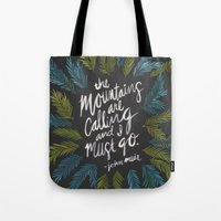 the mountains are calling Tote Bags featuring Mountains Calling – Charcoal by Cat Coquillette