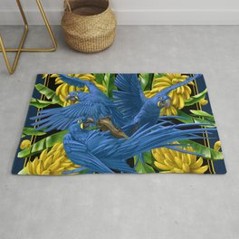 Hyacinth Macaws and bananas Stravaganza (black background). Rug