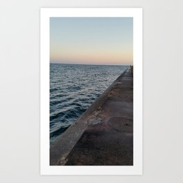 Standing alone on the breakwall Art Print