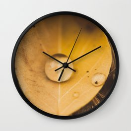 Yellow drop on a leaf Wall Clock