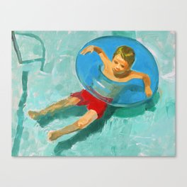 Boy in blue float ring Canvas Print