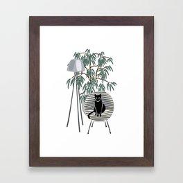 black cat on the chair Framed Art Print