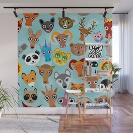 Seamless pattern cute face funny animals on blue background. Vector Wall Mural