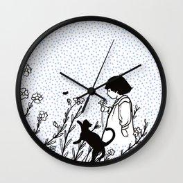 Vintage child in blue, walking in wild flowers Wall Clock