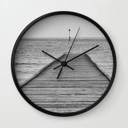 Dis a piering Wall Clock
