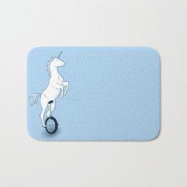Unicorn on a unicycle - blue Bath Mat