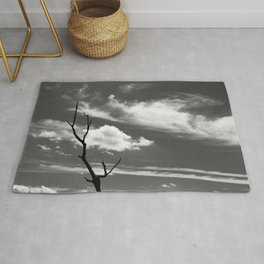 Black and white dead tree and sky with wispy clouds Rug